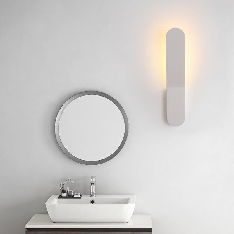 Luces de pared de cabecera de dormitorio nórdico simple moderno LED de moda personalidad arte sala de estar pasillo lámpara