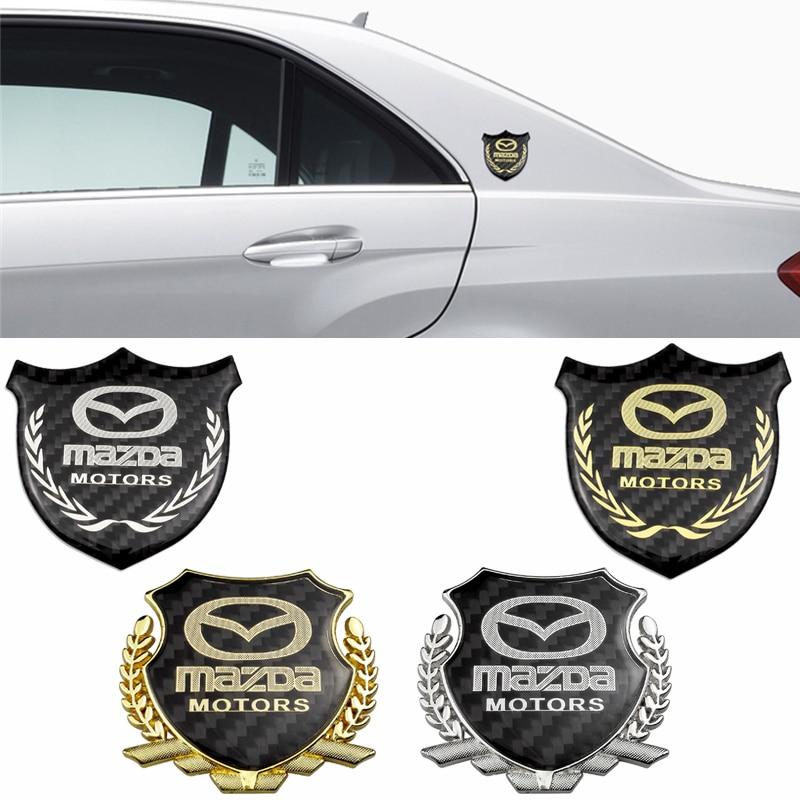 1 pieza insignia de fibra de carbono para CX3 CX5 CX7 CX9 RX7 RX8 RX9 MX 626 Axela Atenza emblema delantero de decoración para automóviles