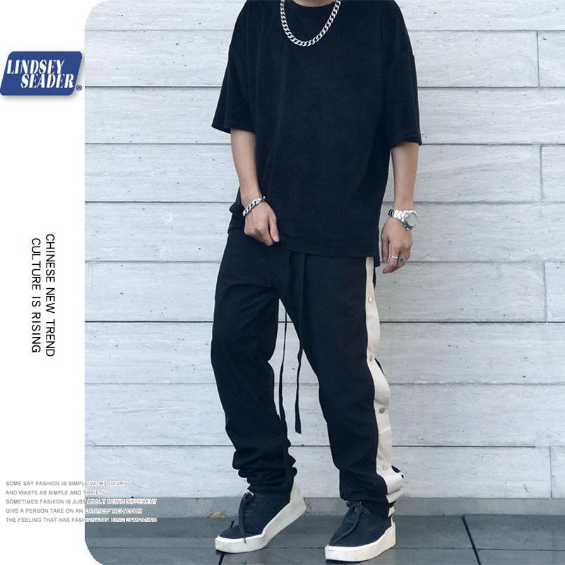 Harajuku pantalón de chándal con botones laterales pantalón con cordones Jogger hombres Casual pantalón de chándal Hip Track pantalones bolsillo de algodón 2020 otoño