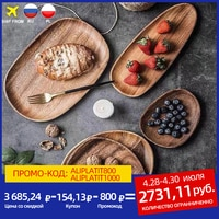 Деревянная тарелка асимметричной формы Посмотреть