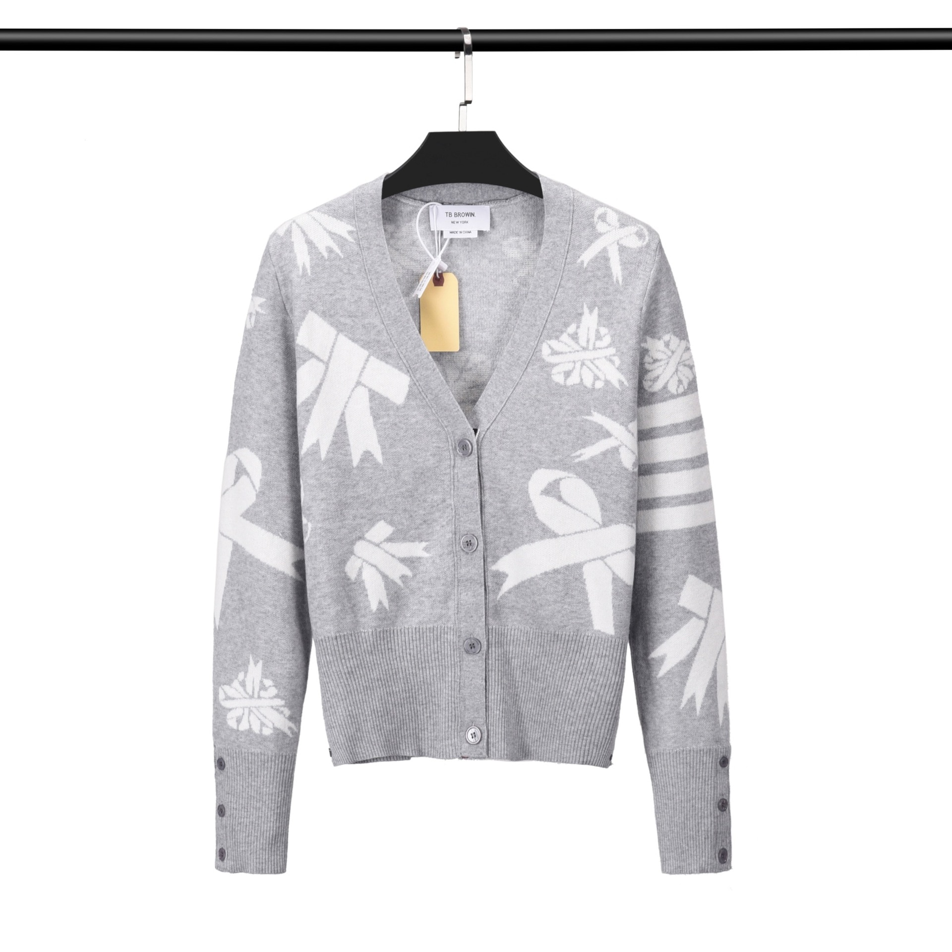 THOM BRUN's new TB women's jacquard bow patterned knit coat is a refreshing and sweet look enlarge