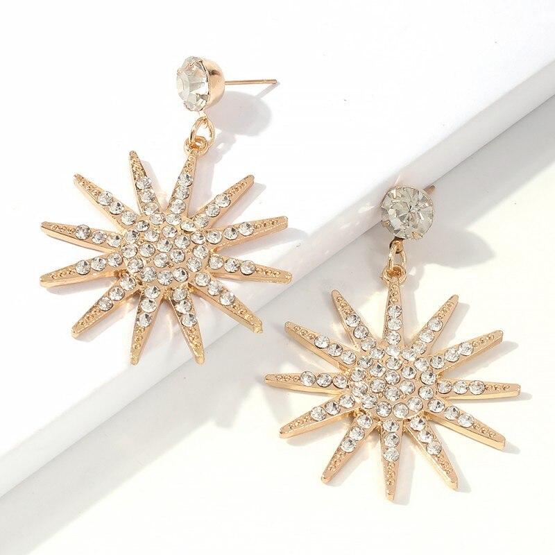 Nuevos accesorios de moda pendientes de aleación de diamantes con forma de copo de nieve para mujer joyería creativa de moda joyería con carácter