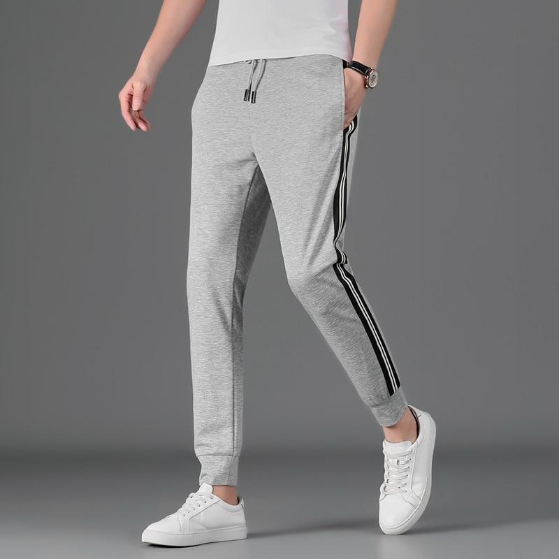 Новинка лета 2021, мужские Модные Повседневные универсальные спортивные брюки и брюки с поясом на резинке