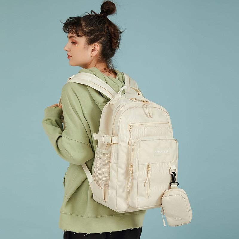 حقيبة السفر ذات سعة كبيرة بسيطة هاراجوكو متعددة المقصورة على ظهره حقيبة ظهر للكمبيوتر لطلاب الجامعات في الصف.