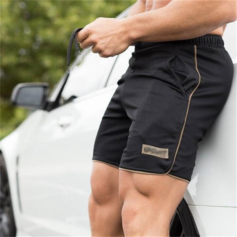 Pantalones cortos deportivos para hombre de ropa de secado rápido para entrenamiento...