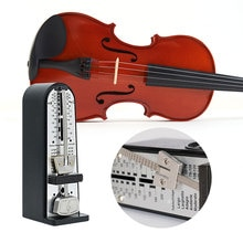 Instrumentos musicales accesorios Torre mecánica Universal clásico mecánico metrónomo para Piano guitarra metrónomo de violín