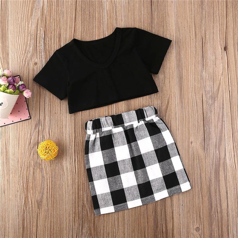 Kostenloser versand Kleinkind Kinder Baby Mädchen Kleidung V-ausschnitt Kurzarm pullover solide Tops Plaid Röcke 2pc neugeborenen baumwolle Outfits