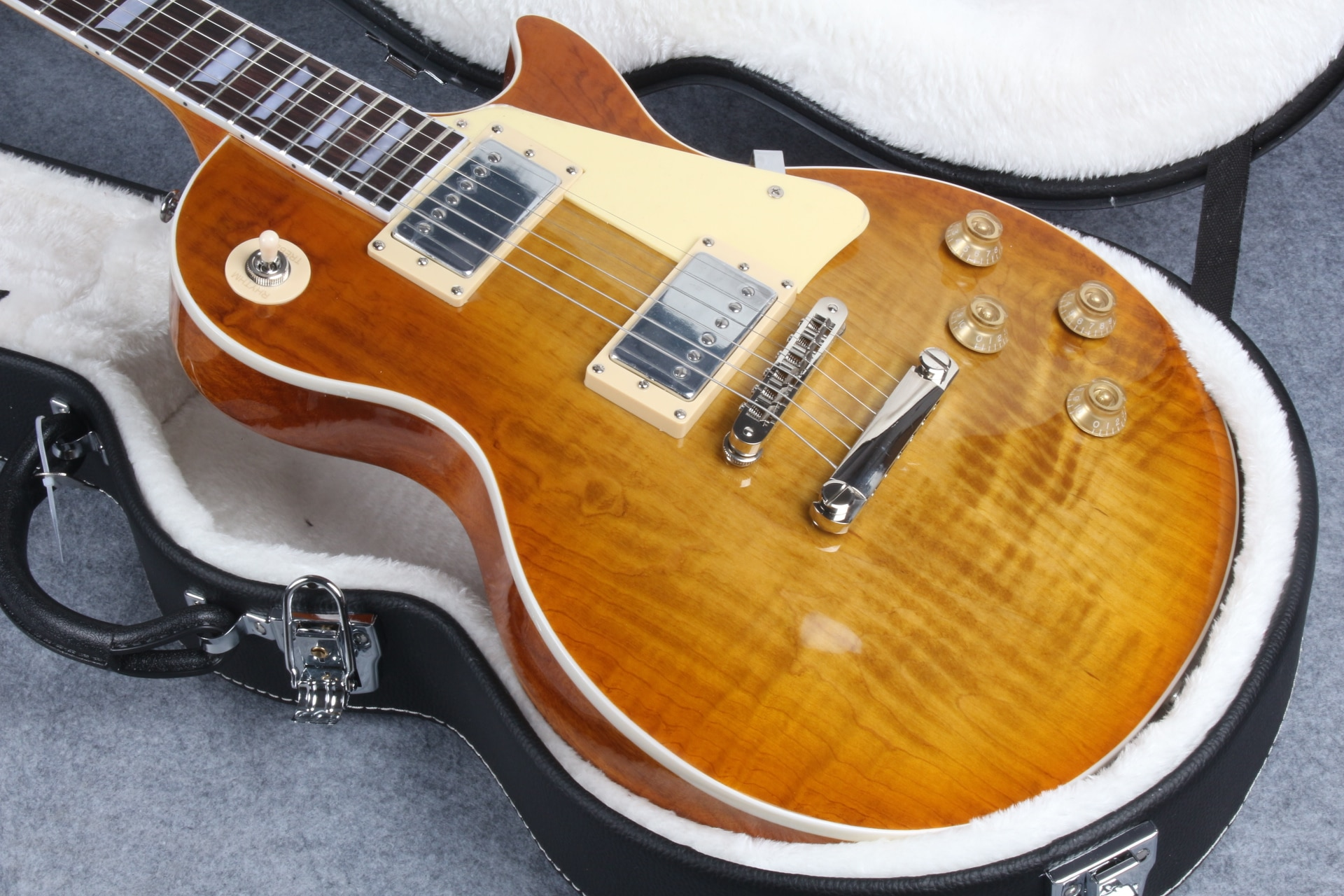 electric guitar,Honey Burst , solid maple cap, mother of pearl inlay,1 pc body 1 pc neck, frets binding, quality guitar