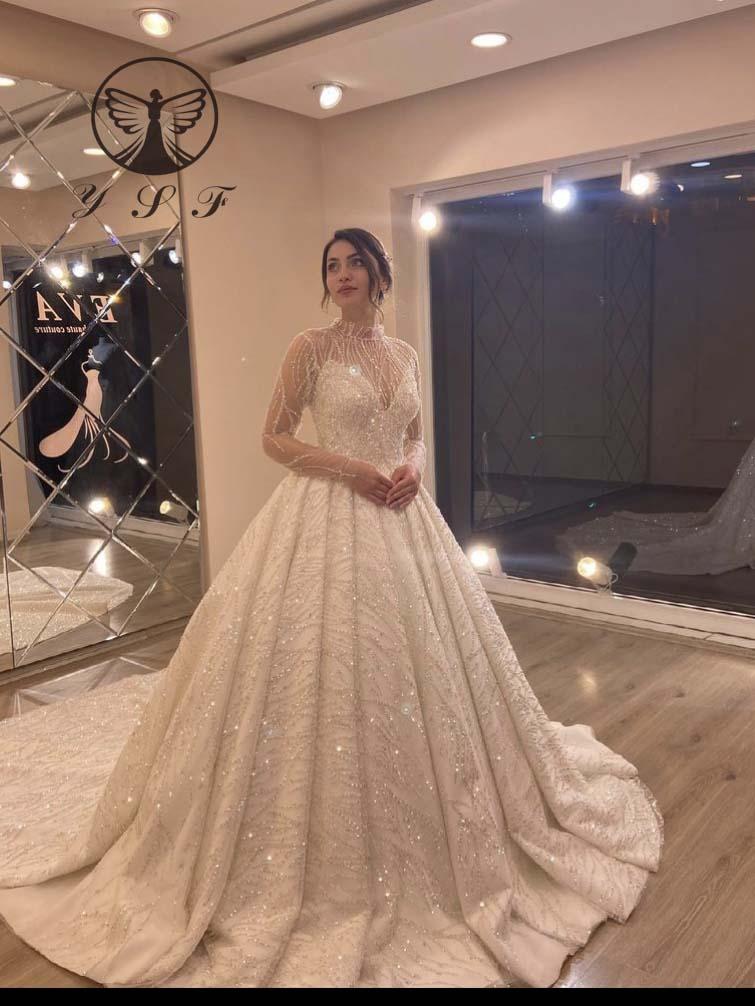 فستان زفاف إسلامي بتصميم عربي فاخر من Vestidos De Novias ذو ياقة عالية وأكمام طويلة من الدانتيل المزيّن بالخرز