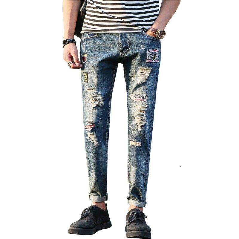 Pantalones vaqueros de tela rasgados de bolsillo de moda para hombre