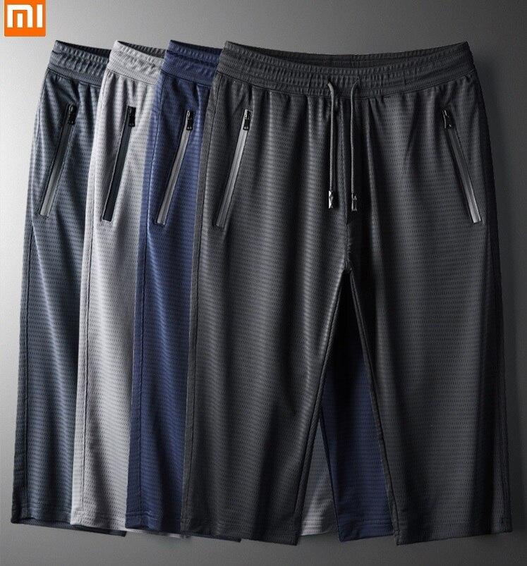 2020 الصيف شبكة الجليد الحرير عادية اقتصاص السراويل الرجال اللياقة البدنية تشغيل سريعة الجافة سراويل قصيرة