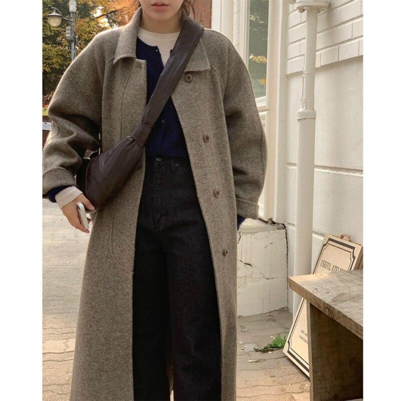 2021 الشتاء الراقية اليدوية مزدوجة الوجهين واحدة الصدر جلد حزام فضفاض حجم كبير متعرجة طويلة 100% معطف الصوف النساء