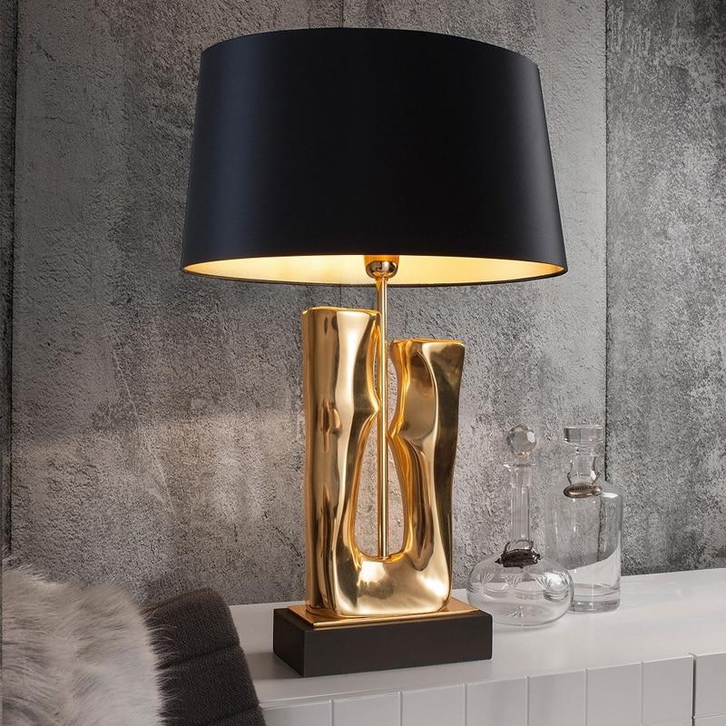 Lámpara de mesa dorada de lujo nórdico Post-lámpara de escritorio moderna Arte Creativo de alta gama de Metal mesita de noche luces decoración interior accesorios de iluminación