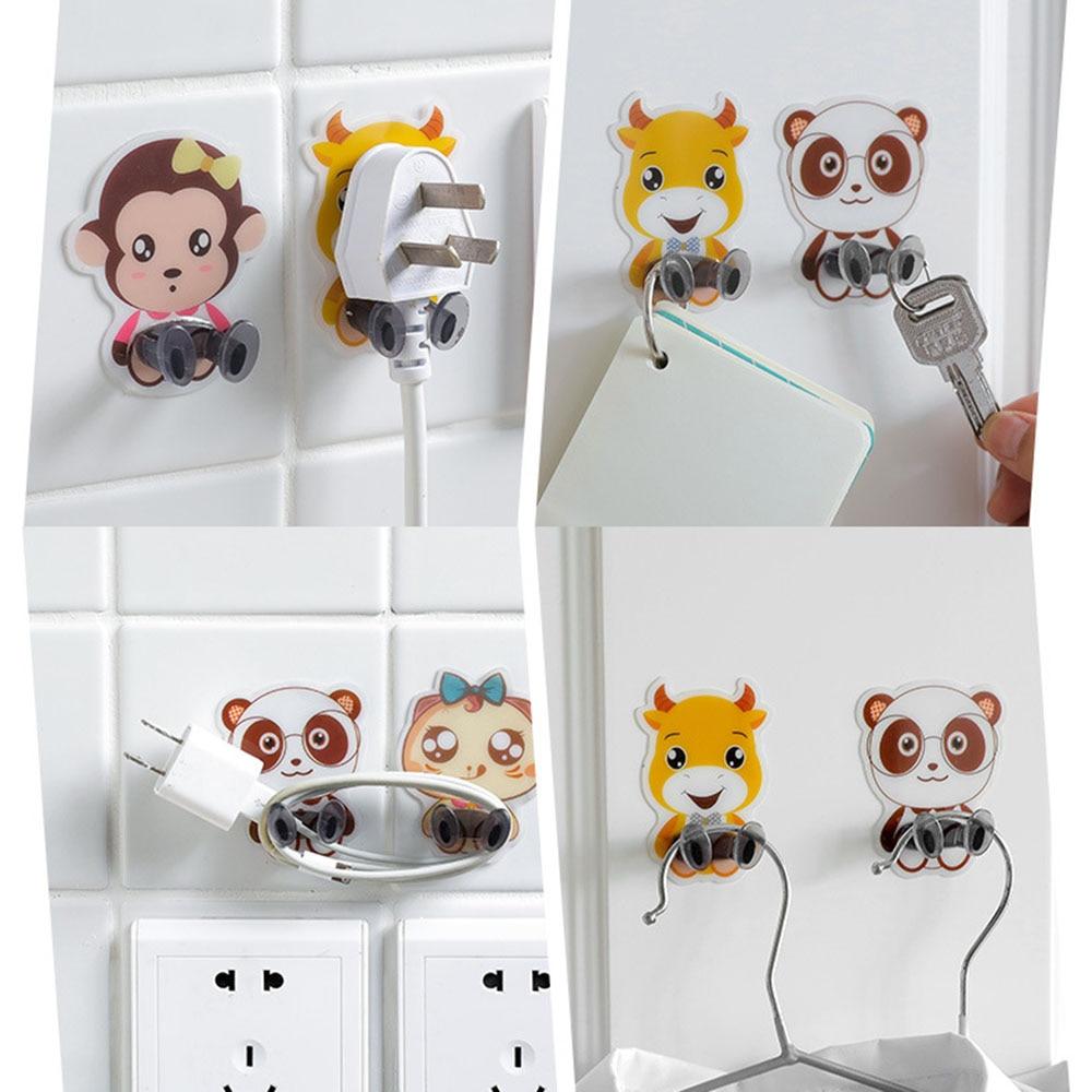 1 pc cabo de alimentação plug bracket wall mounted animais dos desenhos animados resistência adesiva prateleira gancho de armazenamento soquete rack titular