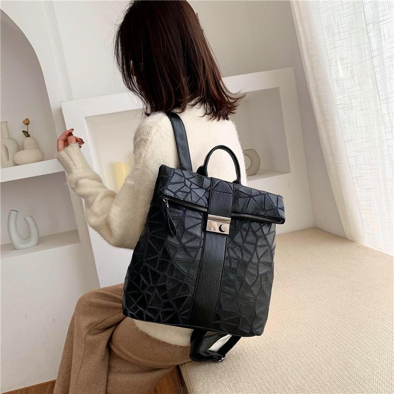 Mochila informal de PU para mujer, mochila negra impermeable para adolescentes, bolsa de viaje con borla de alta calidad