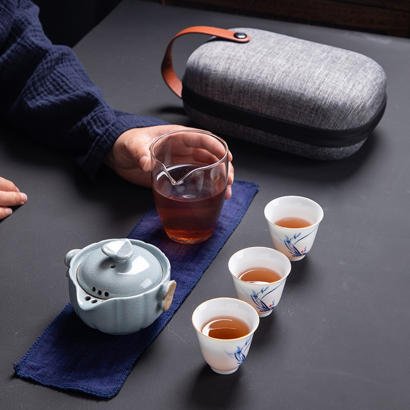 طقم شاي للسفر محمول ياباني وعاء واحد يملأ ثلاثة أكواب Ru فرن السيراميك هدية