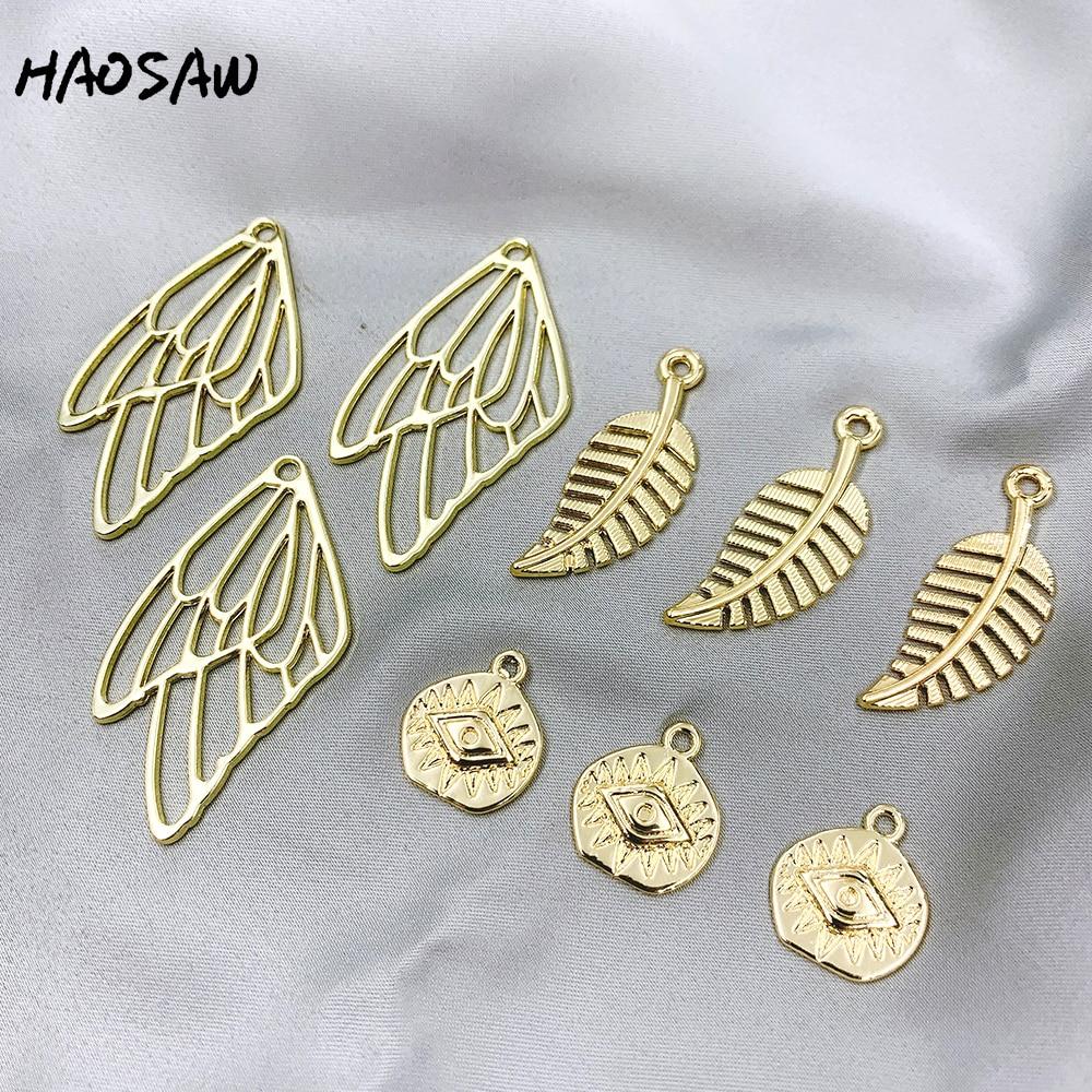 HAOSAW 6 unids/lote elegir/ojos/plumas/hojas/alas/diseños múltiples/hallazgos de joyería/hecho a mano DIY encantos/pendientes de joyería