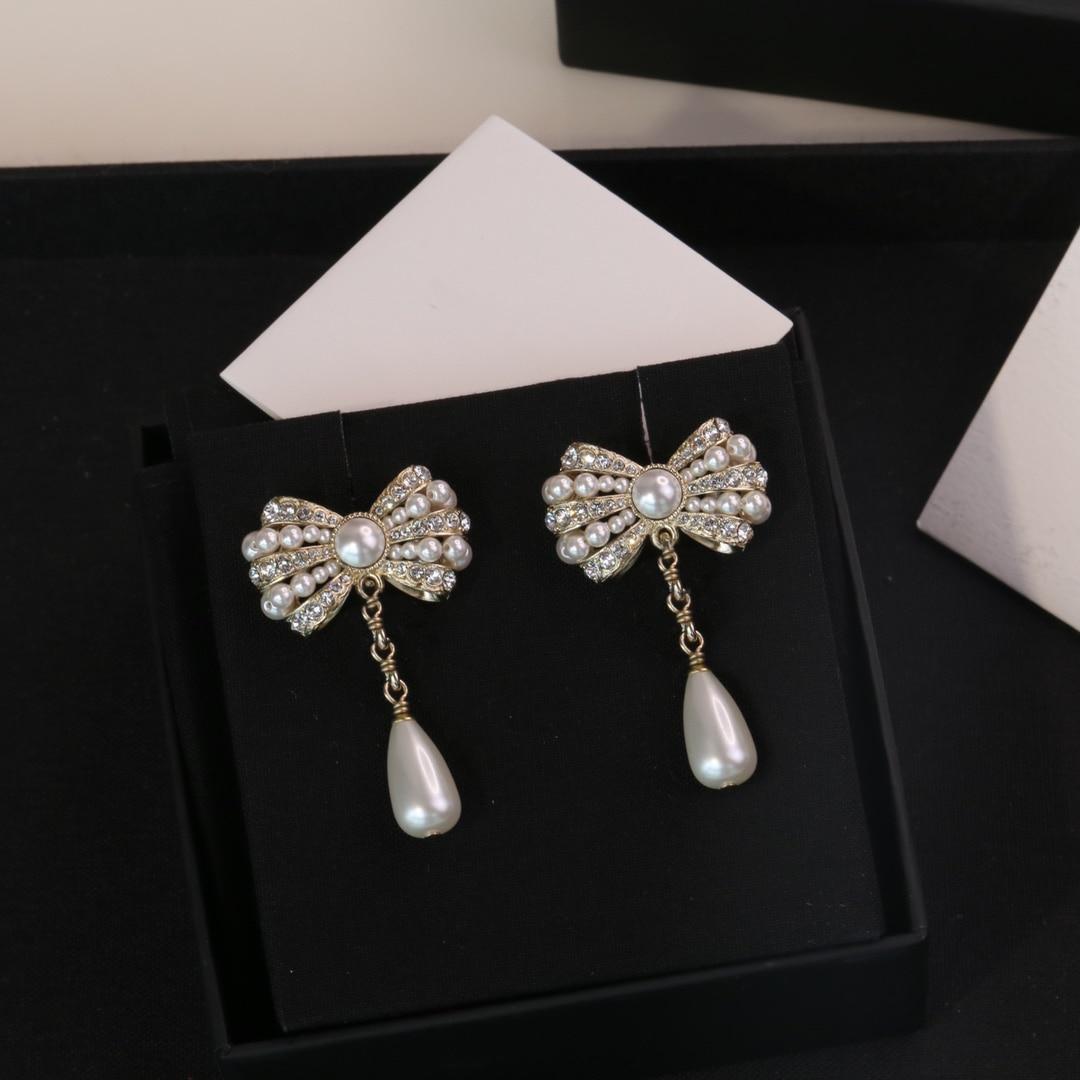 مجوهرات فاخرة عالية الجودة العلامة التجارية القوس الماس كريستال أقراط اللؤلؤ للنساء 2021 الموضة العصرية الساخن الشهير مصمم