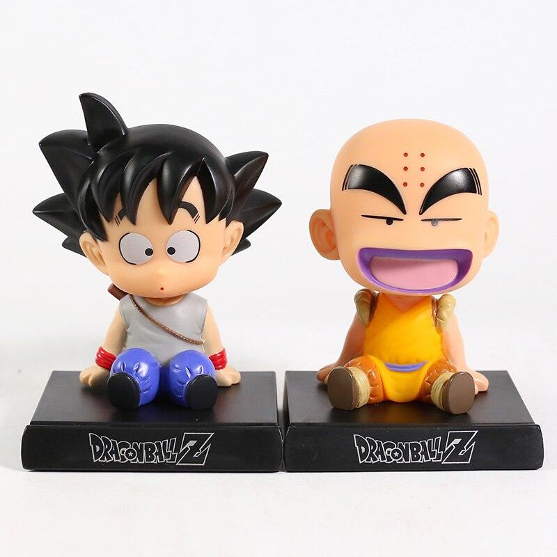 ¡Dragon Ball Z hijo de Goku krillin! Sentado Ver! Figura de PVC soporte para teléfono móvil modelo de juguete