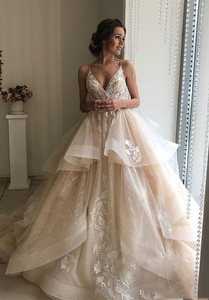 2020 A Line Wedding Dress Spaghetti Straps Sexy V Neck Lace Appliques Bridal Gown Elegant Backless Tiered Skirts Wedding Gowns