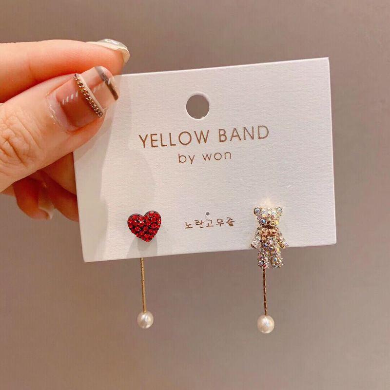 Fashionable cute asymmetric red love imitation pearl bear earrings light luxury creative gift Korean earrings for women.