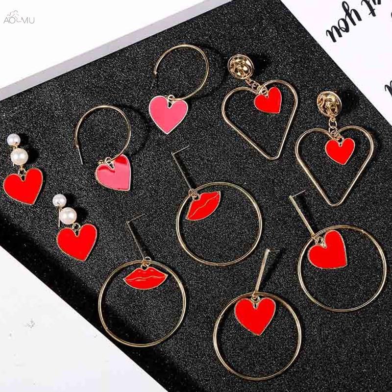 AOMU nuevo Simple geométrico largo pendiente con gota que cuelga para las mujeres rojo corazón labios pendientes malvados pendientes con diseño de ojos perla joyería