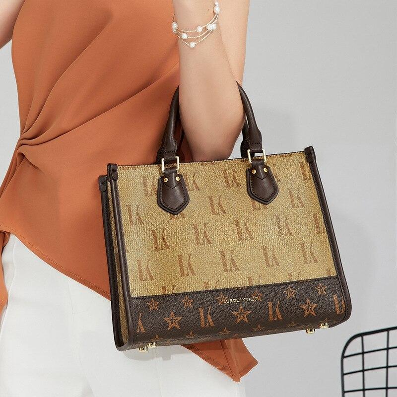 100% جلد طبيعي مربع دلو حقيبة للنساء 2021 جديد قمة الموضة مقبض حقائب كتف فاخرة العلامة التجارية مصمم المحافظ Satchels