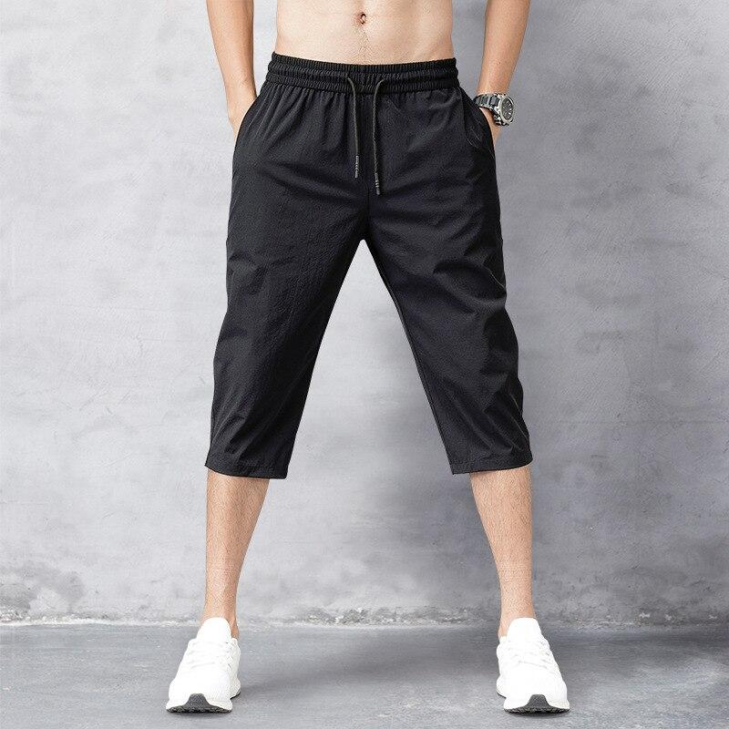 Мужские шорты, летние бриджи, 2021 тонкие нейлоновые брюки длиной 3/4, мужские шорты-бермуды, быстросохнущие пляжные черные мужские длинные шор...