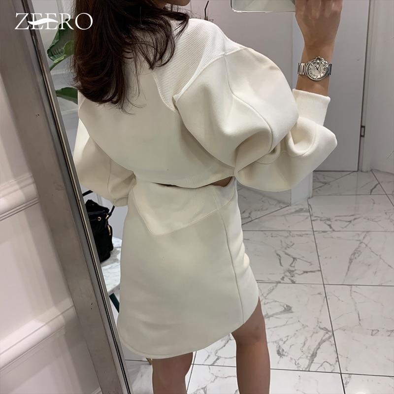 Sudadera Coreana de invierno Sexy Vestidos Mujer blanco Puff manga larga ahueca hacia fuera Mini vestido de las mujeres más de moda gruesa 2019 otoño