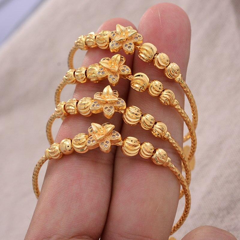 4 unids/lote 24K oro Color brazalete para niñas/Bebé/niños pulsera Vintage campanas joyería de la flor para niños regalos de Navidad de la joyería del grano