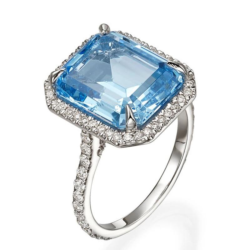 Huitan luxo aaa céu azul cz pedra anéis de noiva graciosa aniversário presente anel para mulher brilhante clássico casamento jóias