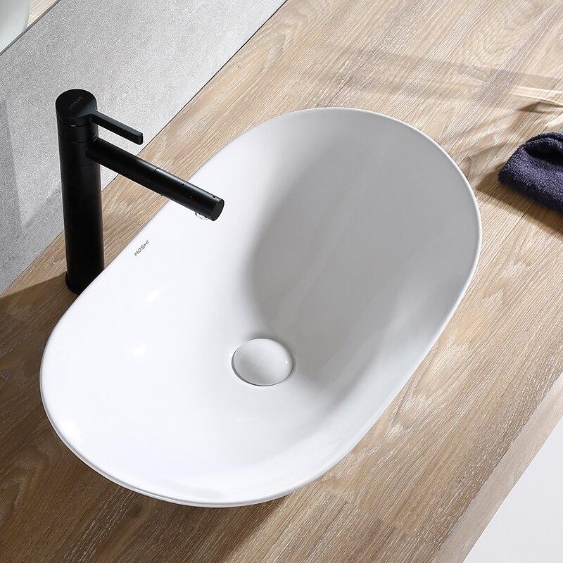 Lavabo nórdico de cerámica, lavabo ovalado, lavabo simple de arte europeo para baño negro, lavabo para el hogar
