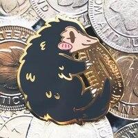 funny niffler hugging galleon hard enamel pin cute cartoon animal monkey golden brooch jewelry magical literature lover gift