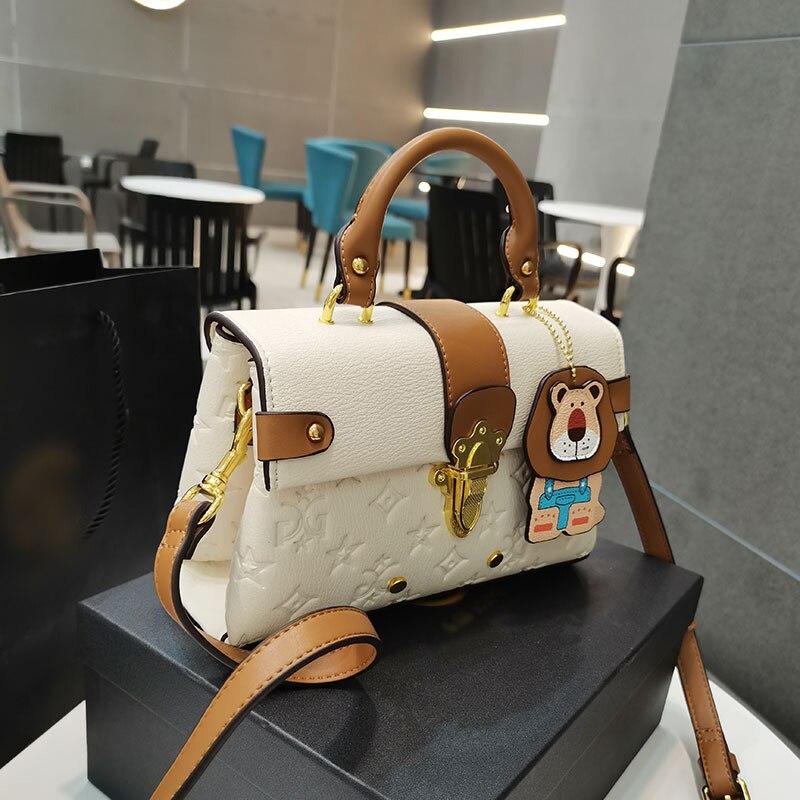 2021 موضة العلامة التجارية مصمم حقائب يد جلدية للنساء زهرة تنقش الذهبي قفل الاتجاه حقيبة كتف عبر الجسم جديد فاخر