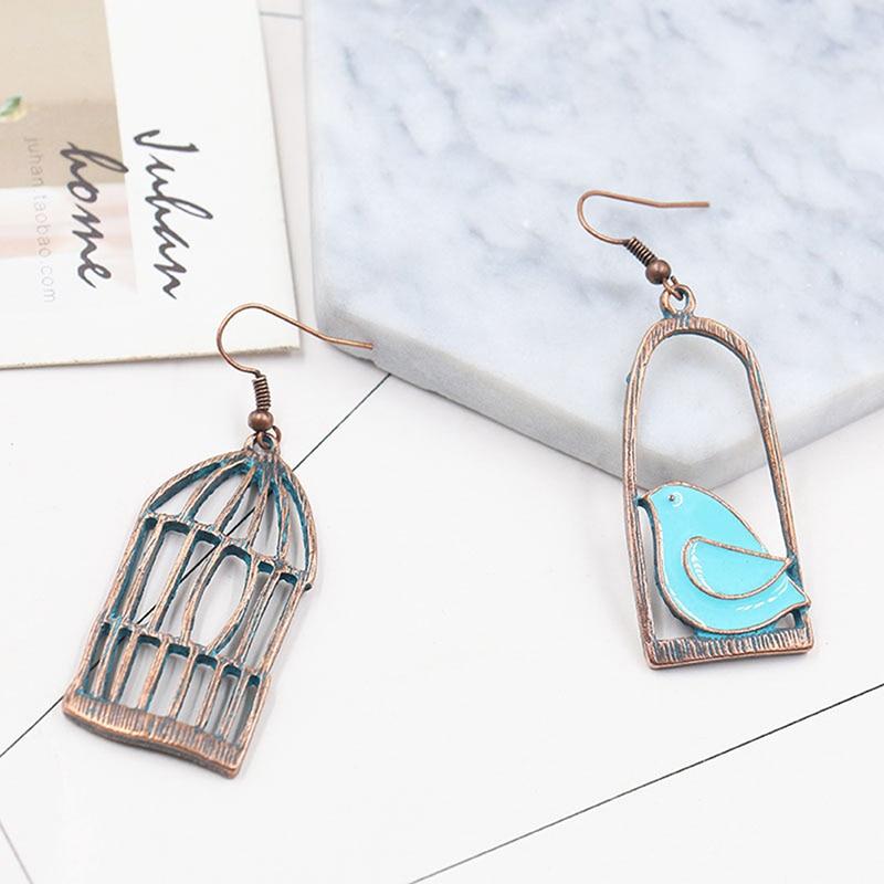 Mujeres creativas jaula de pájaro pendientes colgantes de pájaro asimetría colgante de animal pendientes para mujeres joyería de moda regalo pendientes de pájaro