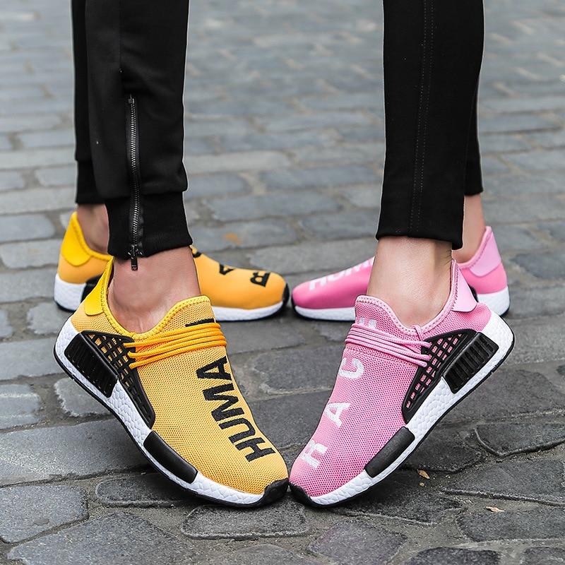 الأصفر الإنسان سباق أحذية رياضية الرجال النساء أحذية خفيفة أنيقة للجنسين تنفس ضوء تشغيل المدرب أحذية مشي تنيس Masculino