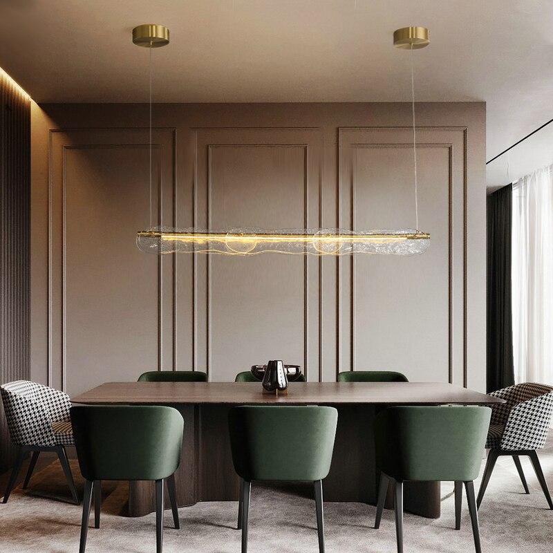 الحديثة غرفة الطعام الثريا ضوء الفاخرة الإبداعية LED قطاع الشمال الحد الأدنى غرفة الطعام منصة مشروبات نمط المياه الزجاج مصباح