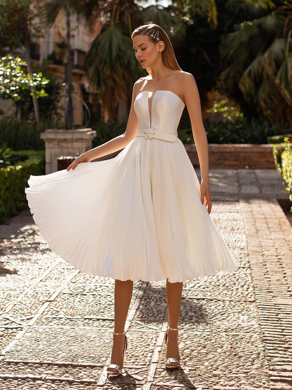 Promo Midi Knee Length Flare Pleated Satin Bridal Gowns Buckle Waist Belt Strapless Transparent Cleavage Wedding Dresses Custom Made