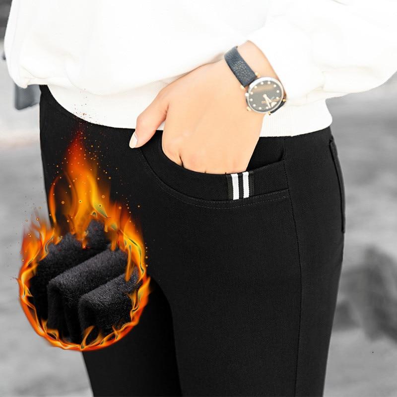 Nuevos pantalones negros cálidos elásticos de cintura alta de invierno ajustados gruesos de terciopelo casual de lana pantalones de Cachemira para mujeres leggings