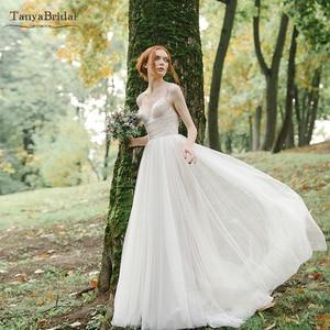 ALine Bohemian Tulle Wedding Dresses spaghetti Floor Length V-Neck Bridal Gowns Beach Vestido de noivas DW309