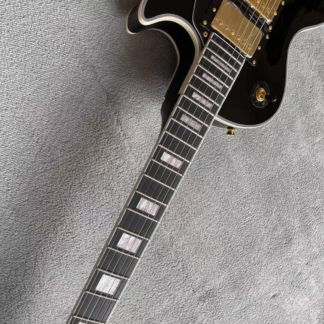 Custom shop.Black color Electric Guitar.High quality 3 pickups.Ebony fingerboard.Mahogany body. enlarge