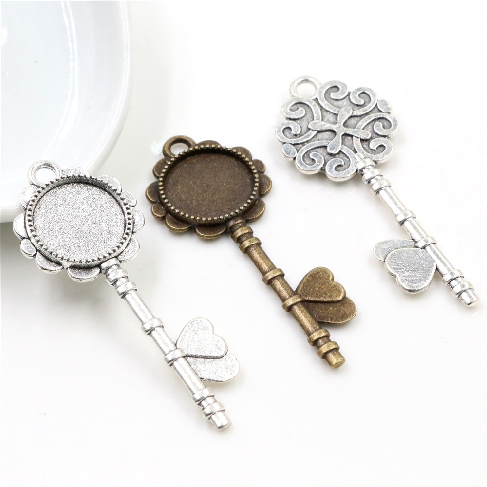 AliExpress - 10pcs 14mm Inner Size Antique Bronze And Silver Plated Key Style Cabochon Base Cameo Setting Charms Pendant