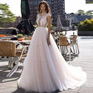 Cap Sleeve Lace Tulle Wedding Dress Appliques Illusion A-Line Princess Bridal Dress Vestido de Noiva Backless Wedding Gown