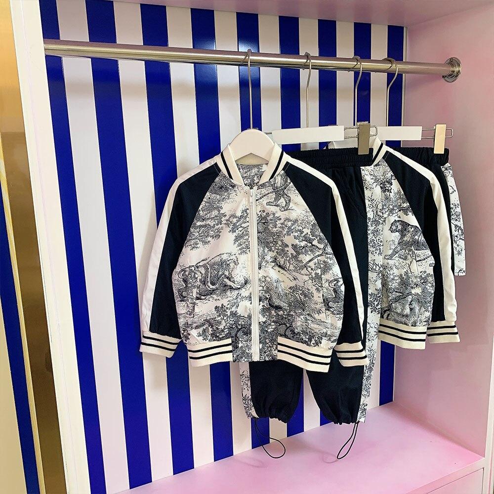 العلامة التجارية تصميم ثوب أطفال 2021 الخريف الشتاء البريطانية الفتيان والفتيات سترة واقية مجموعة الأخ sister السراويل تنورة 2-piece