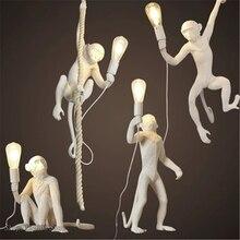 Lámpara colgante de resina con forma de mono para decoración del hogar, luz nórdica de color negro, blanco y dorado para sala de estar, Salón de Arte, sala de estudio