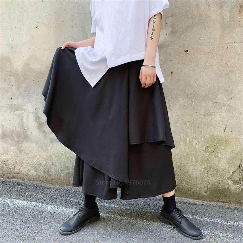 Irregular Japón hombre Samurai traje de pierna ancha empalme falda pantalones ocio hombre Kimono pantalones sueltos Harajuku ropa informal estilo Hip Hop