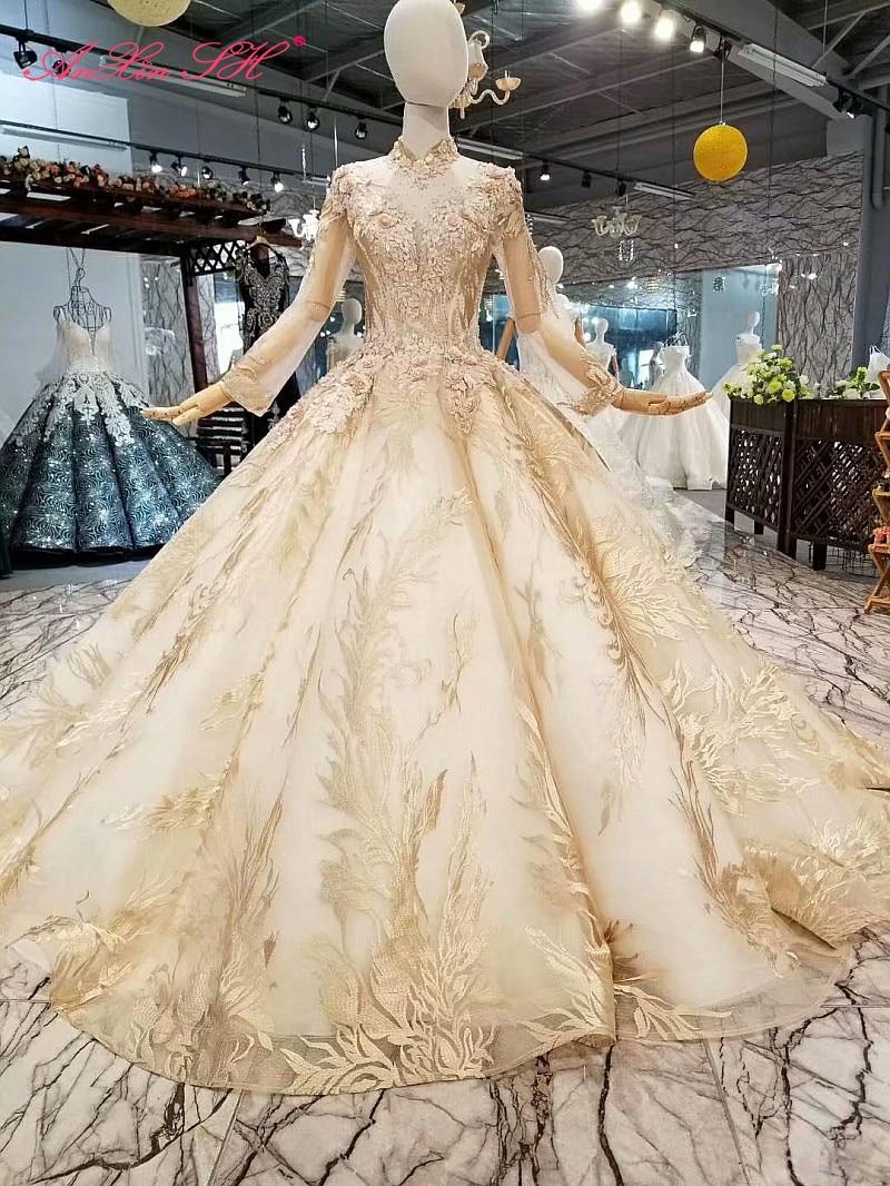 AnXin SH الفاخرة الأميرة الشمبانيا زهرة الدانتيل الديكور كريستال عالية الرقبة سباركلي طويل كم فستان الزفاف 100% ريال صور