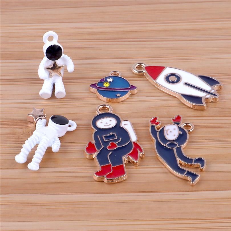 12 Uds. Colorido astronauta espacio universo Rocket esmalte encanto para hacer joyas moda pendiente colgante abalorios para pulsera o collar