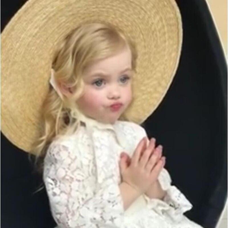 Sombrero grande respetuoso con el medio ambiente Natural de moda con el vendaje niños sombrero de paja forma cóncava fotografía sombrero de paja del protector solar