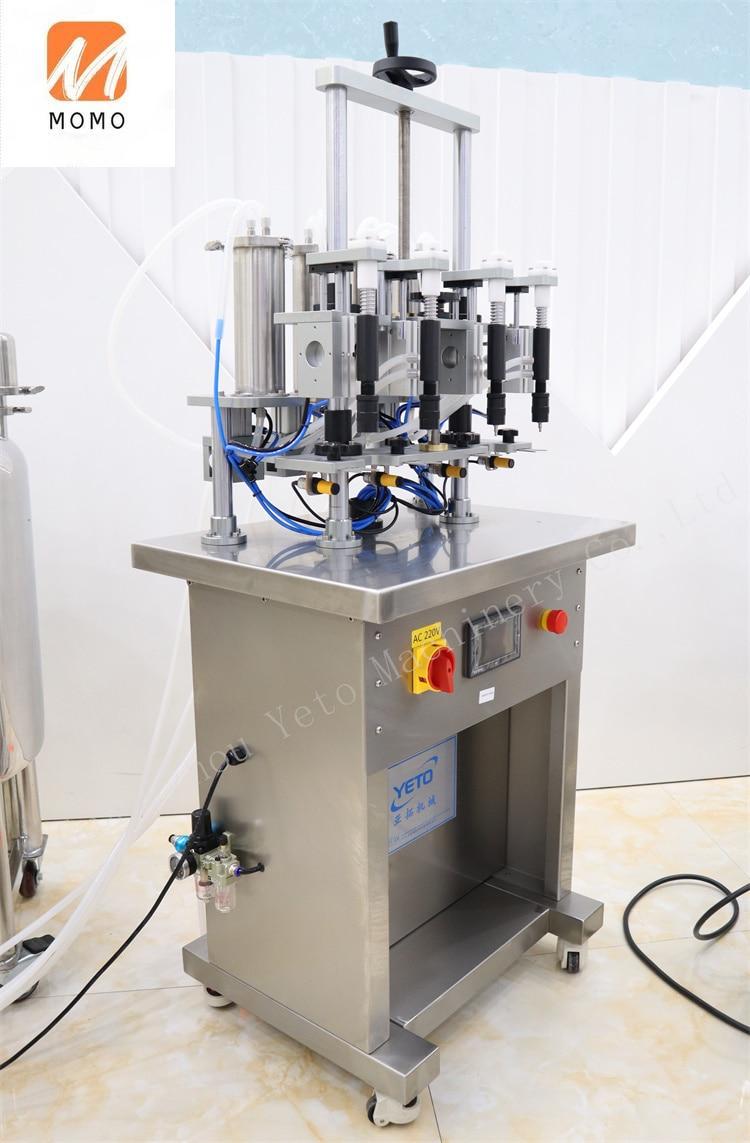 YTF-4 vacuum liquid filler four nozzles automatic small bottle perfume filling machine price